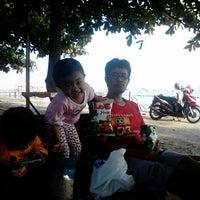 Photo taken at Dampo Awang Beach by tuti'x I. on 10/26/2013