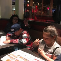 Photo taken at Red Robin Gourmet Burgers by Raul G. on 3/16/2017