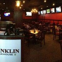 Photo taken at Franklin Steakhouse & Tavern by Oscar B. on 12/19/2012