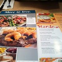 Photo taken at Ninety Nine Restaurant by Jamie C. on 2/20/2013