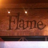 Photo taken at Flame Rotisserie Grill & Bar by Ariana C. on 4/5/2012