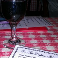 Photo taken at Filippi's Pizza Grotto by Vincent F. on 3/30/2012