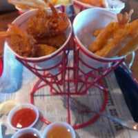 Photo taken at Bubba Gump Shrimp Co. by Jeff C. on 6/28/2012