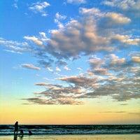 Photo taken at Guacyara Beach by Rodrigo S. on 4/6/2012
