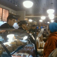 Photo taken at Starbucks by Adrian A. on 12/14/2011