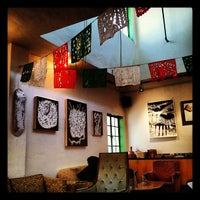 Photo taken at Zona Rosa Caffe by Marco R. on 6/4/2012