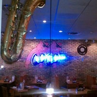 Photo taken at Red Hot & Blue  -  Barbecue, Burgers & Blues by Dre D. on 1/25/2012