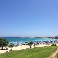 Photo taken at Makronissos beach by Angelina T. on 6/7/2012