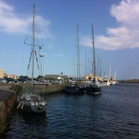 Photo taken at Olbia by Alissia T. on 8/30/2012