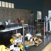 Photo taken at Awaken Cafe by X on 3/19/2012