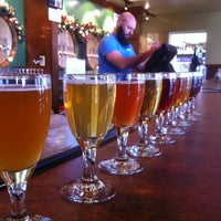 Photo taken at Cascade Brewing Barrel House by Brad C. on 12/3/2011