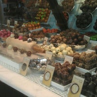 Photo taken at Godiva Chocolatier by Ashley N. on 9/16/2011