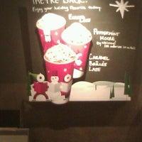 Photo taken at Starbucks by Erin M. on 12/4/2011
