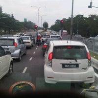 Photo taken at Traffic Light Gate UiTM Seksyen 7 by Awal S. on 11/3/2011