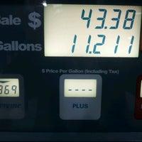 Photo taken at Chevron by Bryan A. on 3/30/2012