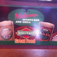 Photo taken at Maloney's Sports Bar & Grill by Tom C. on 7/13/2011