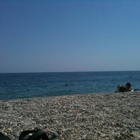 Photo taken at Spiaggia Di Fondachello by Andrea L. on 8/18/2011