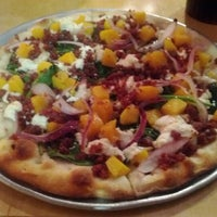 Photo taken at Gusto Pizza Co. by Justin S. on 2/10/2012