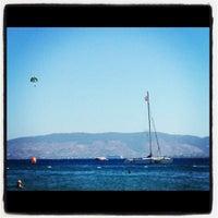 Photo taken at Hayat Bana Güzel Beach by Elif U. on 9/1/2012