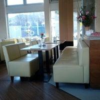 Photo taken at am café lounge by Caspar Clemens M. on 1/26/2012
