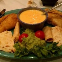 Photo taken at Pericos Mexican Cuisine by Edgar E. on 10/23/2011