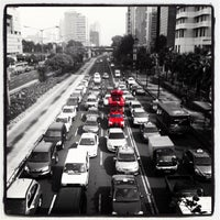 Photo taken at Jalan Jenderal Sudirman by thomas f. on 11/30/2011