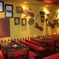 Photo taken at Tappas Caffé by Tappas C. on 6/20/2011