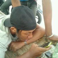 Photo taken at Warkop Pak Gampang by Dendy S. on 12/14/2011