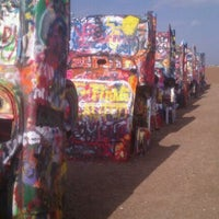 Photo taken at Cadillac Ranch by Adam H. on 7/2/2011