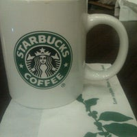 Photo taken at Starbucks by Nikolas S. on 1/2/2012