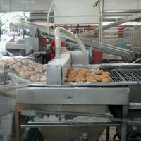 Photo taken at Krispy Kreme Doughnuts by melissa m. on 7/25/2012
