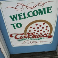 Photo taken at Two Brothers Pizza by Alison C. on 3/17/2012