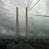 Photo taken at The Queen Elizabeth II Bridge by Greg K. on 4/9/2012