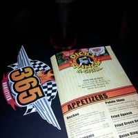 Photo taken at Dick's Wings & Grill by TheenaTheen @. on 8/31/2012