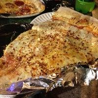 Photo taken at Jumbo Slice Pizza by ben m. on 5/14/2012