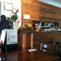 Photo taken at Mini Mango Thai bistro (New name: Mango on main) by Lewis C. on 8/4/2012