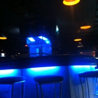 Photo taken at Pipeline Bar & Grill by Benson S. on 2/26/2012