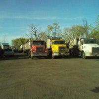 Photo taken at Tramell trucking yard by Michael J. W. on 4/4/2012