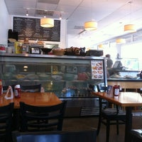 Photo taken at Moore's Delicatessen by Carlos R. on 5/22/2012