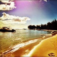 Photo taken at Mont Choisy Beach by Cedric A. on 6/27/2012
