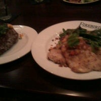 Photo taken at Firebirds Wood Fired Grill by Ralphel W. on 3/26/2012