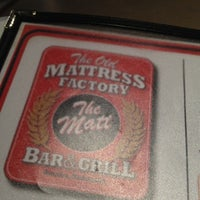 Photo taken at The Old Mattress Factory Bar and Grill by Napatt R. on 7/23/2012