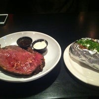 Photo taken at District 7 Grill by Samuel O. on 5/19/2012