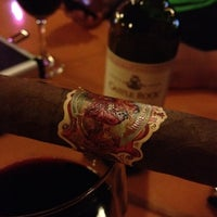 Photo taken at Outman Cigars & Martini Bar by Phil Y. on 7/22/2012