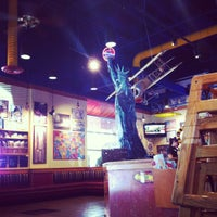 Photo taken at Red Robin Gourmet Burgers by Vitor G. on 6/25/2012