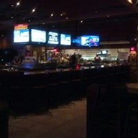 Photo taken at Smokey Bones Bar & Fire Grill by Frank H. on 8/25/2012