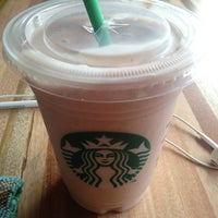 Photo taken at Starbucks by Marcela O. on 9/12/2013