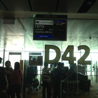 Photo taken at Gate D42 by Simon T. on 12/14/2012