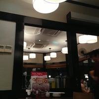 Photo taken at WARAKU Japanese Casual Dining by KT L. on 6/25/2013