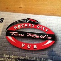 Photo taken at Tom Reid's Hockey City Pub by Brad K. on 5/9/2013